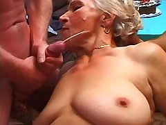 Depraved granny fucks in gangbang and gets facials